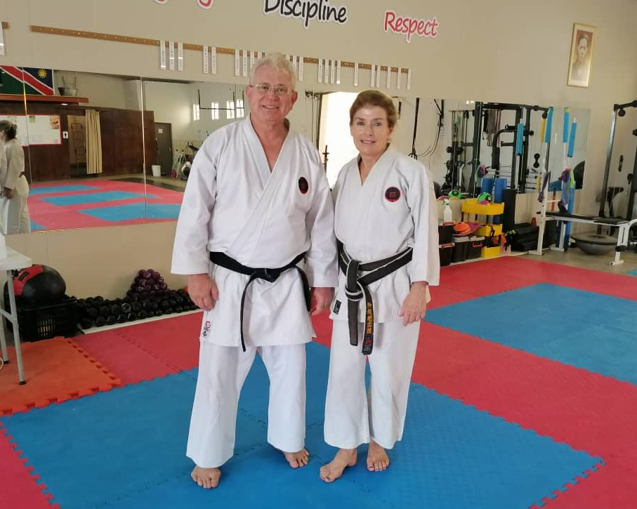 Sensei Karin Brockmann standing with Sensei Carl van der Merwe after successfully completing her grading test!